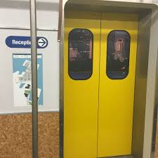 sydney google office. Arriving At The Office In Pyrmont, Elevators Are Designed To Look Like A Train Carriage, With Doors Painted Yellow And Signs Similar Those Sydney Google