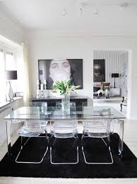 Contemporary dining room design idea: glass dining table and acrylic chairs  with black & white design elements