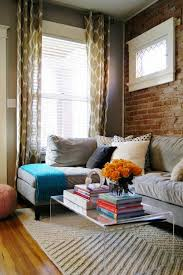 Casual Nook: Just having a brick accent wall can add so much warmth and  color to this cozy living room. (via Decor Pad)