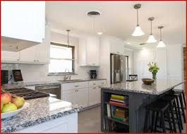 luna pearl granite with white cabinets prettier luna pearl granite countertops give your kitchen a