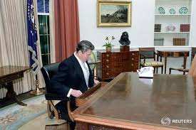 reagan oval office. Ronald Reagan Sits At The Oval Office Desk Following His Inaugural Parade In Washington, January 1981. Presidential Library/Handout Via F