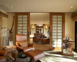 Asian enclosed living room idea in San Francisco with beige walls