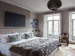 bedroom decorating ideas with gray walls white exposed brick wall white platform bed platform floating bed frame two white three drawers night stand