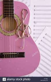 Treble Clef Music Sheet Violet Guitar For Children With Treble Clef On Music Sheets Stock