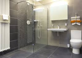 A clean fresh modern walk in shower room with wc basin mirrored cabinet and  shower enclosure