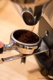 machine dose fine coffee into portafilter