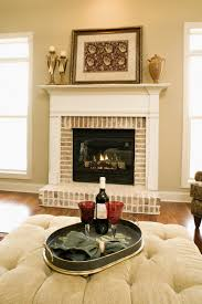 traditional looking fireplace the white wood and natural brick surround