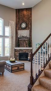 rustic wood wall stone fireplace fischer homes home decor rustic wood walls stone fireplaces and rustic wood