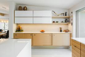Example of a 1960s l-shaped concrete floor kitchen design in Tampa with  flat-