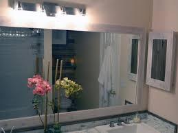 Image Elegant Cidylaneastmanbathroommirrorframeh Diy Network How To Replace Bathroom Light Fixture Howtos Diy