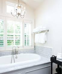 classy chandelier over bathtub tub in bright white bathroom light code soaking electrical image