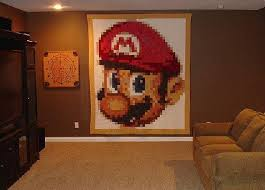 Giant Mario quilt -- a honey of a gamer crafter project / Boing Boing & My wife made this quilt featuring Nintendo's Mario about five years ago.  The quilt is made up of 16 different fabrics (4 bit color) and is 36  columns ... Adamdwight.com
