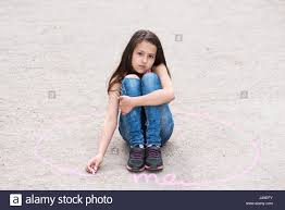 Girl sitting on ground