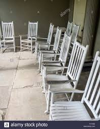 white wooden rocking chair. White Rocking Chairs. A Collection Of Wooden Chairs On The Patio Below Chair