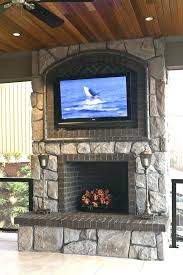 hanging tv above fireplace interesting idea hanging