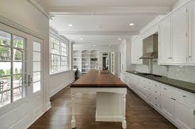 modern white kitchen with large island in luxury home how our st peters mo cabinet painting service works