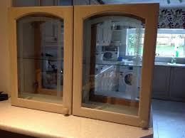 double sided kitchen cabinets with a light oak finish