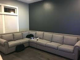 what color rug goes with a gray couch i have a big light grey couch with grey walls the back wall is a darker grey than the rest of the walls my