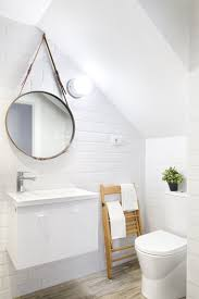 modern round bathroom mirror. round hanging bathroom mirror for fascinating decor with sloped ceiling design ideas and using modern white paint color s