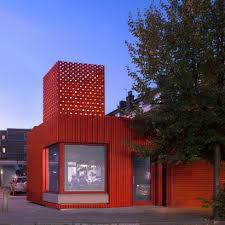 we made that adds bright red metal extension to east street library in london