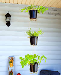 lampshades repurposed into hanging herb baskets