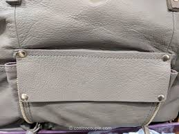this bag was created for and distributed by costco whole it is no longer available this bag is a supple cream pebble leather with gold hardware