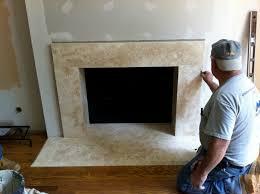 close up of crema marfil fireplace surround