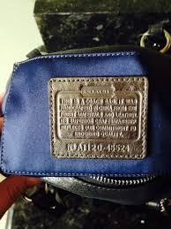 smaller coach purse with a coach leather creed patch inside this is 45524