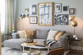 gold black and white are a classic color scheme that work wonderfully in a formal living room design
