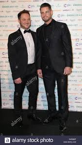 Mikey Graham and Keith Duffy arrive at The Emeralds And Ivy Ball in aid of  Cancer Research UK at Old Billingsgate Market in London Stock Photo - Alamy