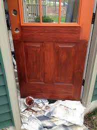 applying faux woodgrain door