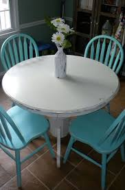 painted round kitchen table diy white chalk paint on wood round table turquoise chairs
