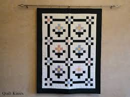 Quilt Kisses: Different Ways to Hang Quilts & I love it because there is no need to add a hanging sleeve. Just use the  clips to hold it up. Adamdwight.com