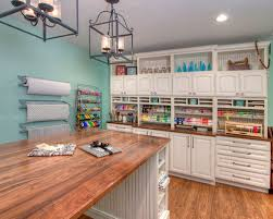 craft room lighting. large traditional medium tone wood floor craft room idea in st louis with blue walls lighting g