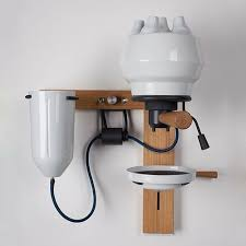 A wall-mounted espresso machine by Arvid Hausser.