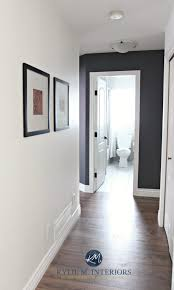 Hallway update with wood look laminate flooring, Sherwin Williams Creamy  and Benjamin Moore Gray feature