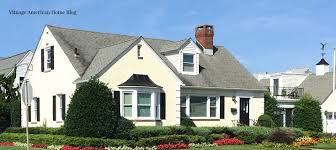 the best outside color schemes are taupe with black shutters and door and creamy white trim
