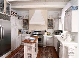 ... Narrow kitchen in white with a gorgeous island at its heart [Design:  Tran +
