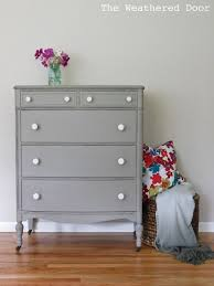 distressed wood furniture. the weathered door a distressed elephant grey dresser with white knobs also has an idea to get out smells in old wood furniture