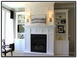 fireplace with bookcases on each side home design ideas