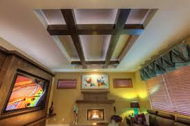 the raised ceiling is accented with maple beams and up lighting ceiling up lighting