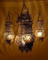 tin lighting fixtures. john hardin aka tin can luminary makes intricate light fixtures out of old cans that he cuts with torches find his work at the gallery functional lighting a