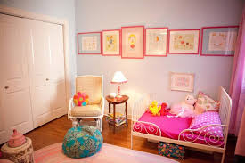 The Whimsical Illustrations In Pink Frames Add A Unique Touch To This  Bright Pink Toddler Girls Bedroom.