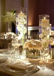 wine glass centerpiece ideas wedding table decorations for a cream wedding giant martini glass centerpieces for