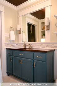 diy bathroom vanity made from inexpensive stock oak cabinets from a big box home improvement