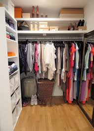 white wooden shelves clothes and shoes feat pole closet design interior hanging the wall also mirror beside wonderful walk ideas modern housing large