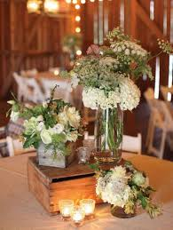 Rustic Wedding Table Setting With Wooden Boxes And Flower Filled