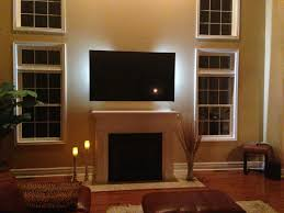 decorations tv over fireplace ideas home design with excerpt stone romantic living room classic white mantel