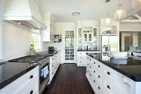 kitchen dark cabinets light granite this gorgeous contemporary kitchen utilizes dark granite counter tops and wood flooring to break up the kitchen