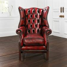 elegant red leather tufted wingback chair with nailhead trim